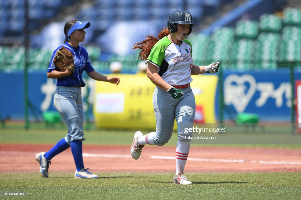 Suzannah Lillian Brookshire Gonzalez #5 of Mexico celebrates with team mates after hitting the game winning RBI single in tiebreak against Italy during their Playoff Round at ZOZO Marine Stadium on day nine of the WBSC Women's Softball World Championship on August 10, 2018 in Chiba, Japan.