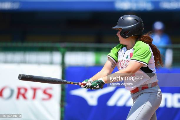 Suzannah Lillian Brookshire Gonzalez of Mexico hits game winning RBI single in tiebreak against Italy during their Playoff Round at ZOZO Marine...