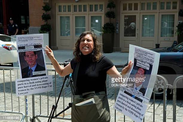 Suzannah Troy shouts in protest in front of the townhouse in the Tribeca area of Manhattan where former IMF head Dominique StraussKahn is being held...