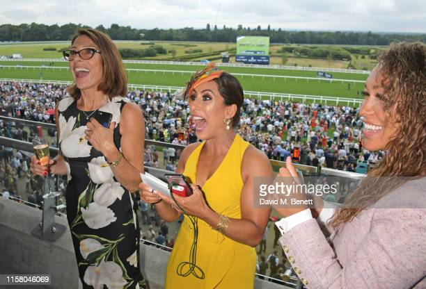 Suzanne Danielle Saira Khan and Rebecca Ferguson attend the King George Weekend at Ascot Racecourse on July 27 2019 in Ascot England