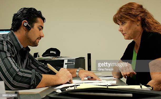 CEO Suzanne DeRossett looks over client contracts with her son company Vice President John DeRossett at Empire Building Services in Santa Ana She has...
