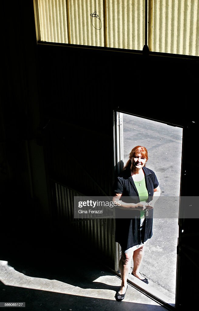 Suzanne DeRossett, president and CEO of Empire Building Services, stands in one of her small supply : News Photo