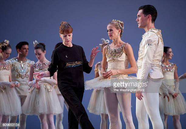 Suzanne Farrell center instructs dancers on the ballet Diamonds Dancers are Heather Ogden and Michael Cook right The Suzanne Farrell Ballet company...