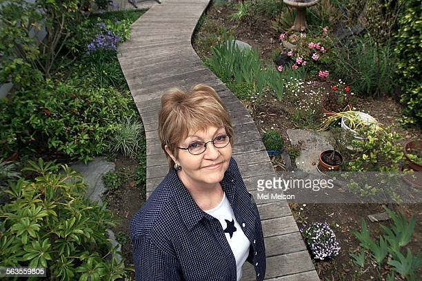 Suzanne Graham stands on side deck next to her draught resident garden in backyard of her home in Port Hueneme where she was lived for the past 6...