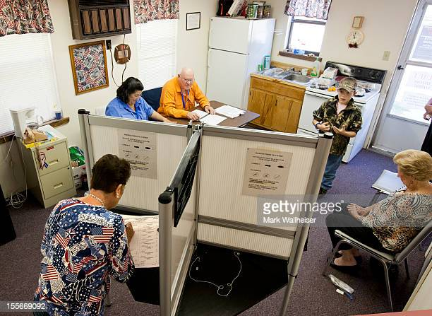 Suzanne Grant votes in one of only two cubicles in the tiny precinct of Smith Creek on November 6 2012 in Sopchoppy Florida The swing state of...