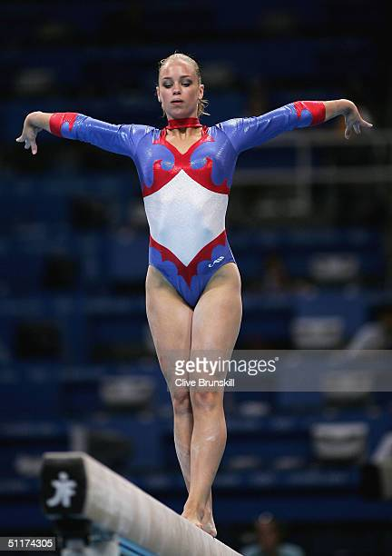 Suzanne Harmes of the Netherlands competes on the beam in the qualification round of the team event at the women's artistic gymnastics competition on...