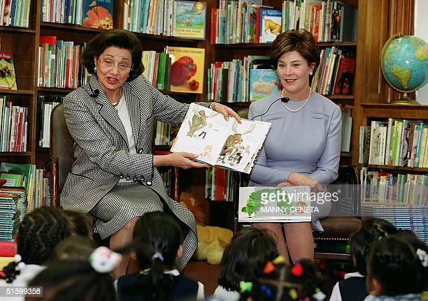 Suzanne Mubarak , wife of Egyptian President Hosni Mubarak reads a story to children as US First Lady Laura Bush looks on during a celebration of...