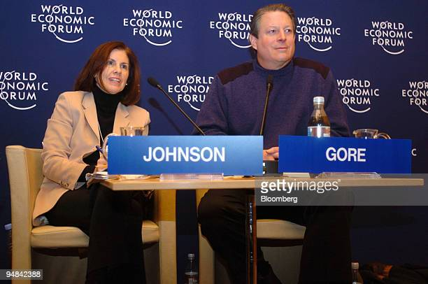 Suzanne Nora Johnson left chairman of the Global Markets Institute Goldman Sachs Group and former US VicePresident Al Gore participate in a session...