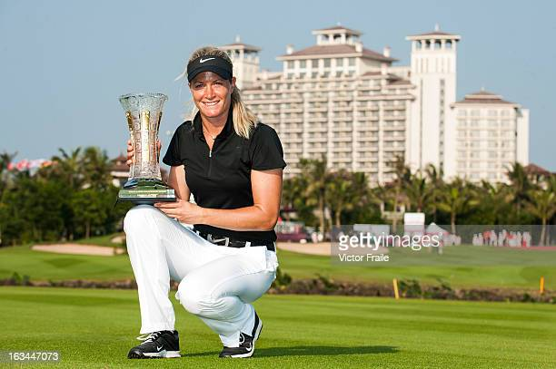 Suzanne Pettersen of Norway poses with the trophy after winning the Mission Hills World Ladies Championship at Mission Hills' Blackstone Course on...