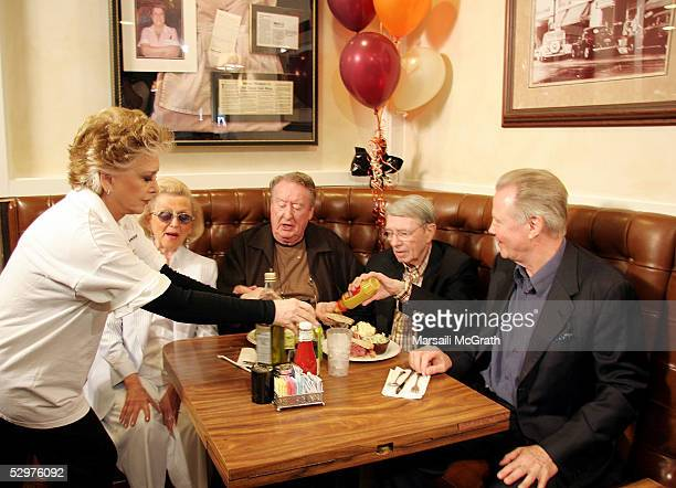 Suzanne Pleshette serves lunch to Barbara Davis Tom Poston an unidentified guest and Jon Voight at a party celebrating the 60th anniversary of Nate...