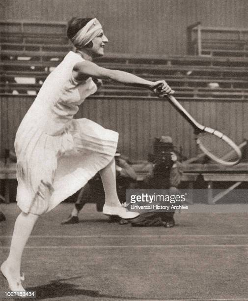 Suzanne Rachel Flore Lenglen, 1899 - 1938 French tennis player Seen here playing at Wimbledon in 1919 when she won the title From These Tremendous...