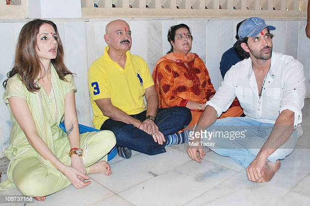 Suzanne Roshan Rakesh Roshan and Hrithik Roshan performing Puja on the occasion of MahaShivRatri at a temple in Panvel Mumbai