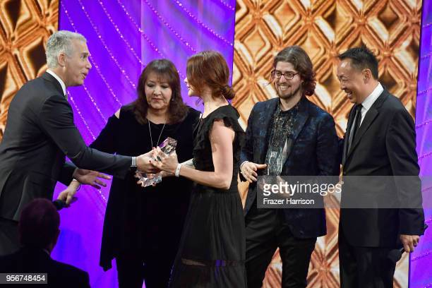 Suzanne Santo and Benjamin Jaffee accept award from BMI Vice President Creative Film TV Visual Media Doreen Ringer Ross Executive Vice President of...