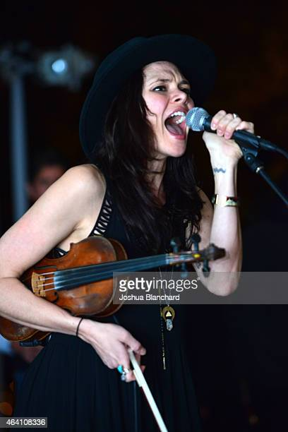 Suzanne Santo of honeyhoney performs at the Treats Magazine PreOscar Party at the Treats Villa presented by OMNIA on February 21 2015 in Los Angeles...