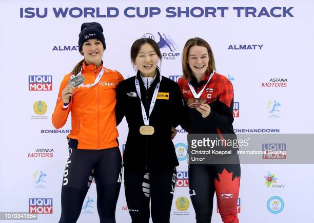 Suzanne Schulting of Netherlands poses during the medal ceremony after winning the 2nd place Choi Minjeong of South Korea poses during the medal...