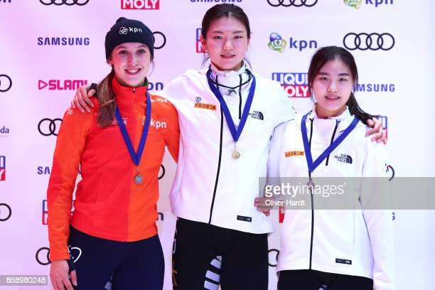 Suzanne Schulting of Netherlands with the silver medal Hee Suk Shim of Korea with the gold medal and Yu Bin Lee of Korea with the bronze medal...