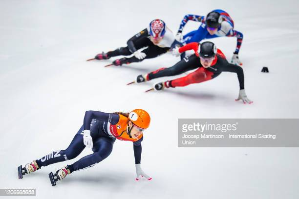 Suzanne Schulting of team Netherlands leads ahead of team Canada, team Korea and team Russia in the Ladies Relay Final during day 2 of the ISU World...