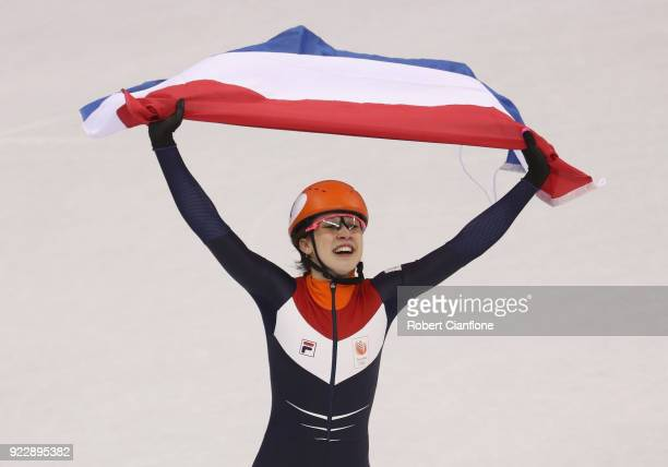 Suzanne Schulting of the Netherlands celebrates after she won gold in the Ladies' 1000m Finals Short Track Speed Skating on day thirteen of the...