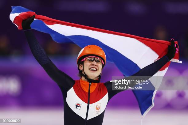 Suzanne Schulting of the Netherlands celebrates winning gold in the Ladies' 1,000m Short Track Speed Skating Final A on day thirteen of the...
