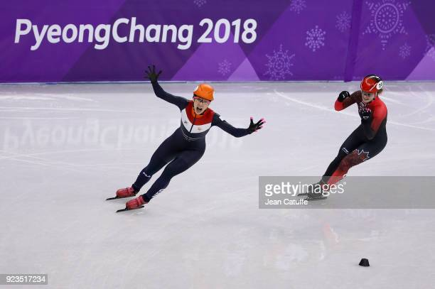 Suzanne Schulting of the Netherlands competes and wins before Kim Boutin of Canada during the Short Track Speed Skating Women's 1000m Final A on day...