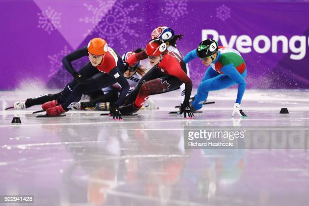 Suzanne Schulting of the Netherlands leads as Sukhee Shim and Minjeong Choi of Korea crash during the Short Track Speed Skating Ladies' 1000m Final A...