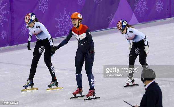Suzanne Schulting of the Netherlands wins front of Sukhee Shim of South Korea and Minjeong Choi of South Korea during the Short Track Speed Skating...