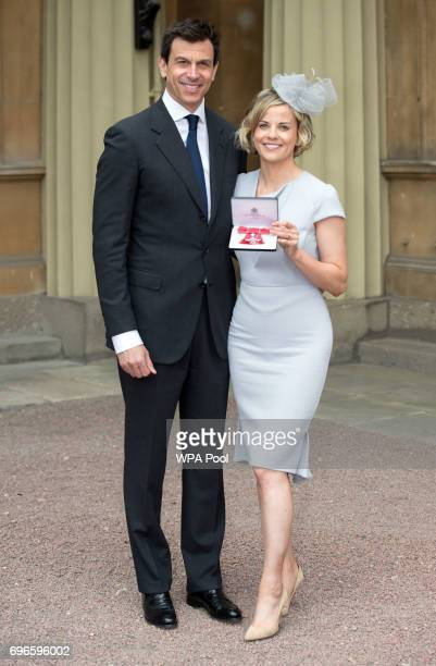 Suzanne Wolff with her husband Toto after she was awarded an MBE by the Prince of Wales during an Investiture ceremony at Buckingham Palace on June...
