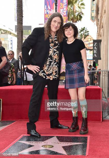 Suzanne Yankovic and Nina Yankovic attend a ceremony honoring Weird Al Yankovic with the 2643rd star on the Hollywood Walk of Fame on August 27 2018...