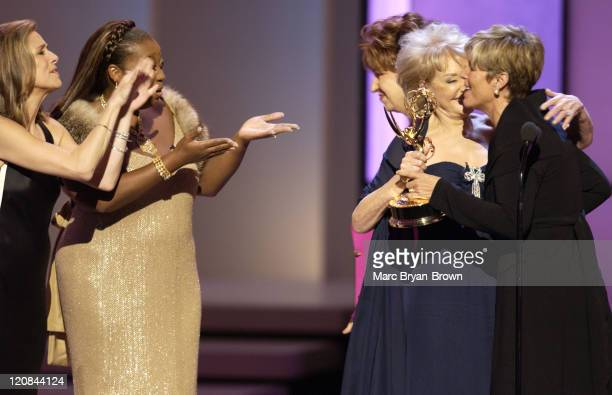 Suze Orman accepts the award for Outstanding Service Show Host for 'The Suze Orman Show' from Barbara Walters as Meredith Vieira and Star Jones...
