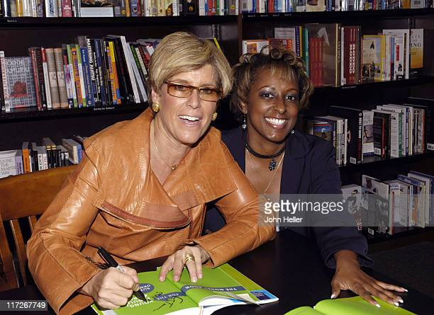 Suze Orman signs a copy of her book for J'Tamera Johnson