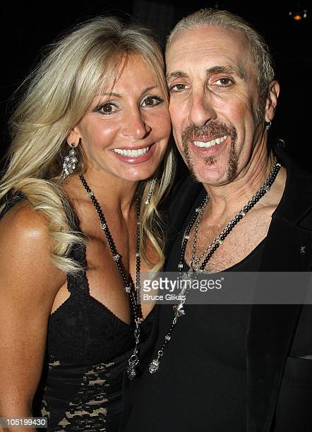 Suzette Snider and husband Dee Snider pose at The Opening Night Party for his debut in Rock of Ages on Broadway at The Glass House Tavern on October...