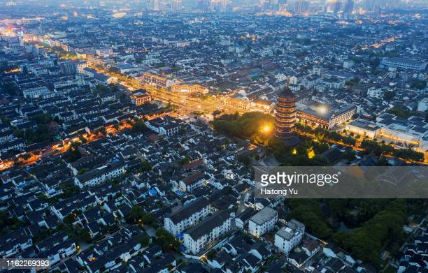 Suzhou, China. Aerial image at night showing traditional residential area and the Beisi Pagoda