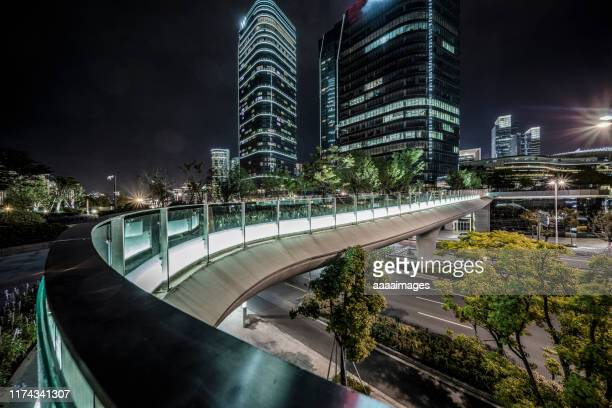 suzhou downtown at night - elevated walkway stock pictures, royalty-free photos & images