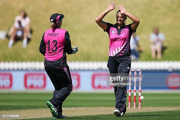 Suzie Bates and Rachel Priest celebrate the wicket of Jess Jonassen of Australia during match one of the TransTasman Twenty20 Series at Basin Reserve...