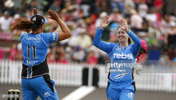 Suzie Bates congratulates AmandaJade Wellington of the Strikers after taking the wicket of Sixers Ellyse Perry during the Women's Big Bash League...
