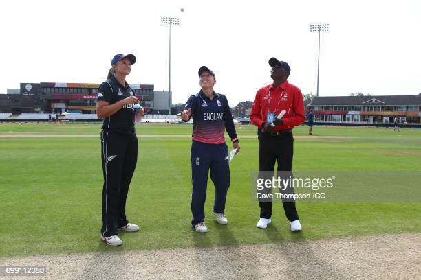 Suzie Bates of New Zealand and Danielle Hazell of England toss the coin alongside Umpire Langton Rusere at the beginning of the ICC Women's World Cup...