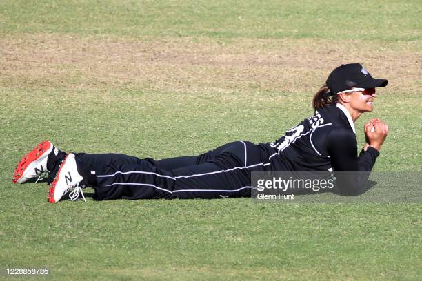 Suzie Bates of New Zealand catches out Beth Mooney of the Australia during game one in the women's One Day International Series between Australia and...
