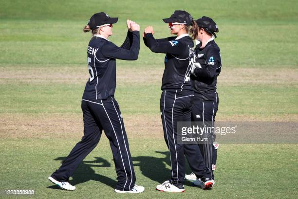 Suzie Bates of New Zealand celebrates with her teammates after catching out Beth Mooney of the Australia during game one in the women's One Day...