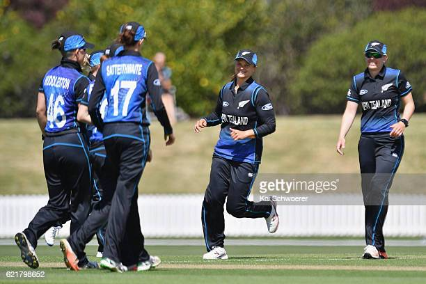 Suzie Bates of New Zealand celebrates with teammates after Morna Nielsen dismisses Nahida Khan of Pakistan during the Women's One Day International...