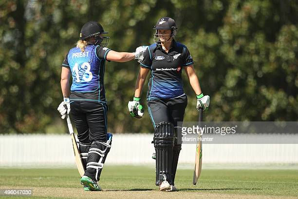 Suzie Bates of New Zealand is congratulated by Rachel Priest during the Third Women's One Day International match between New Zealand and Sri Lanka...