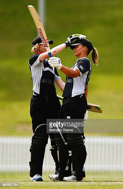 Suzie Bates of New Zealand is congratulated by team mate Haidee Tiffen after scoring a century during the ICC Women`s World Cup 2009 Super Six match...