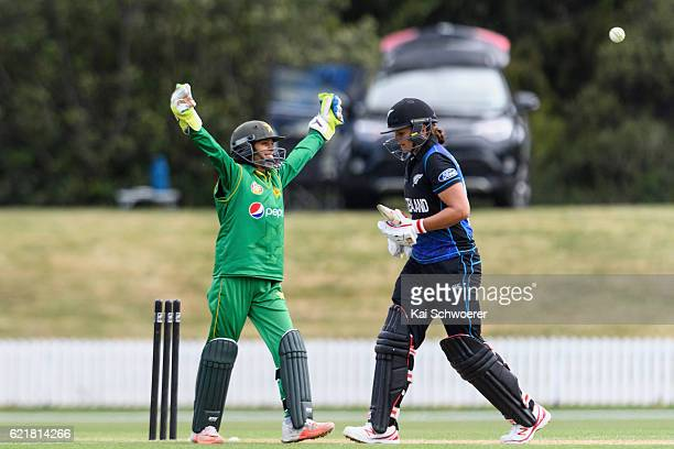 Suzie Bates of New Zealand looks dejected after being dismissed by Sana Mir while Sidra Nawaz of Pakistan celebrates during the Women's One Day...