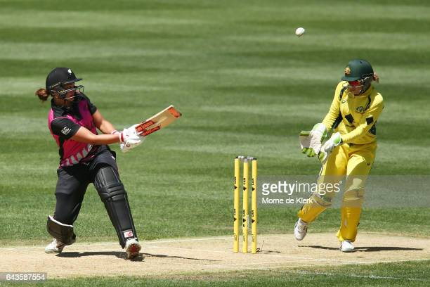Suzie Bates of New Zealand plays a ramp shot over Alyssa Healy of Australia during the Women's Twenty20 International match between the Australia...