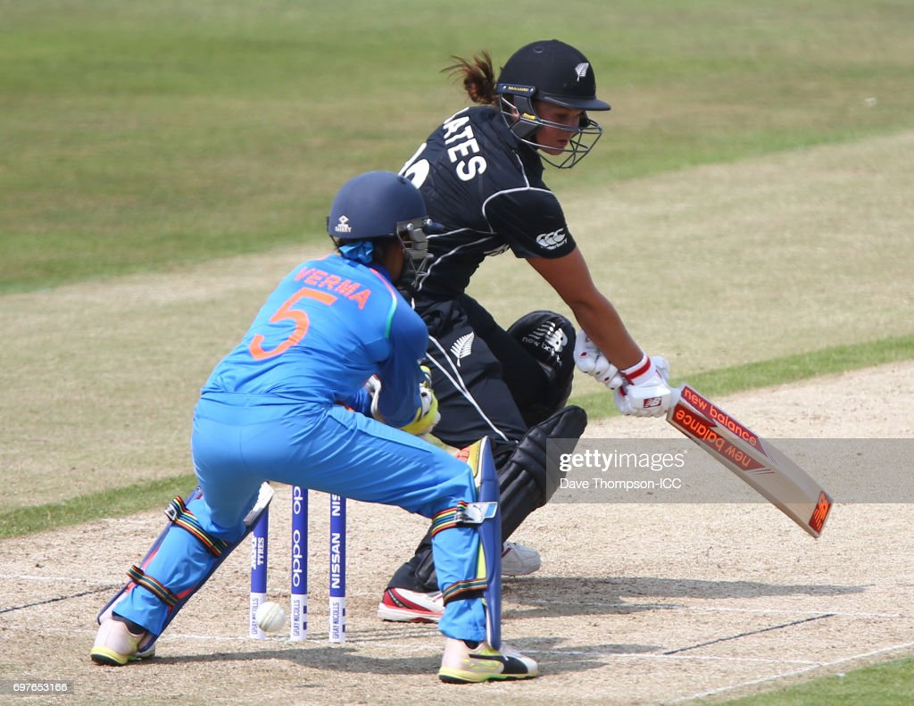 Suzie Bates of New Zealand plays a shot though the legs of Sushma Verma of India during the ICC Women's World Cup warm up match between India and New Zealand at The County Ground on June 19, 2017 in Derby, England.