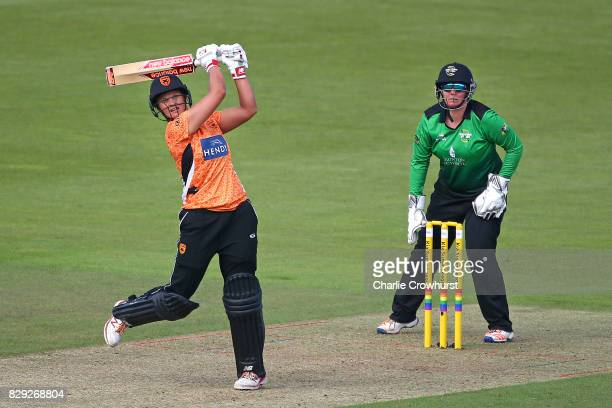 Suzie Bates of Southern Vipers hits out while wicket keeper Rachel Priest of Western Storm looks on during the Kia Super League Match between...