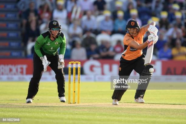 Suzie Bates of Southern Vipers hits out while wicket keeper Rachel Priest of Western Storm looks on during the Women's Kia Super League Final between...