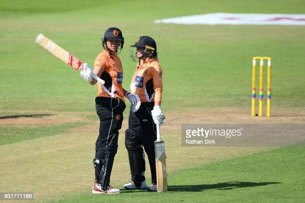 Suzie Bates of Southern Vipers raises her bat after scoring 100 runs during the Kia Super League 2017 match between Loughborough Lightning and...