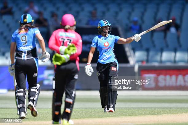 Suzie Bates of the Adelaide Strikers celebrates after reaching her half century during the Women's Big Bash League match between the Adelaide...