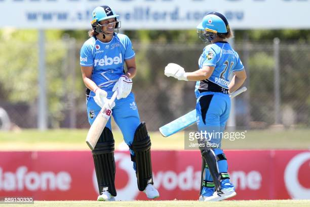 Suzie Bates of the Adelaide Strikers celebrates her century with Bridget Patterson during the Women's Big Bash League WBBL match between the Strikers...