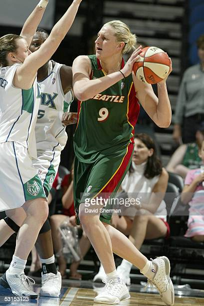 Suzie Batkovic of the Seattle Storm looks to pass against the Minnesota Lynx on June 26 2005 at the Target Center in Minneapolis Minnesota NOTICE TO...